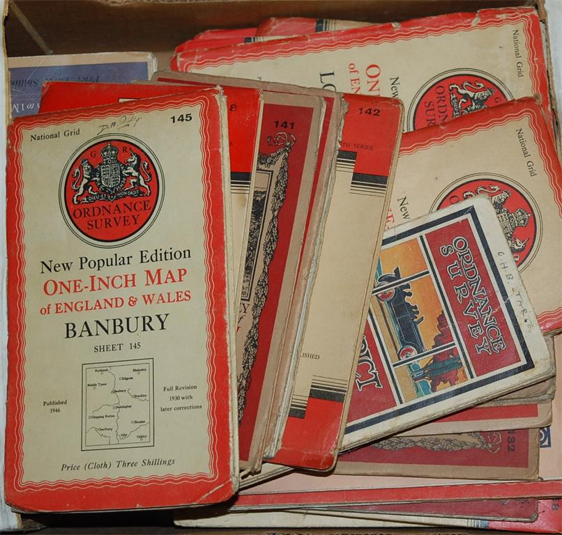 A box of assorted mid-20th century Ordnance Survey maps