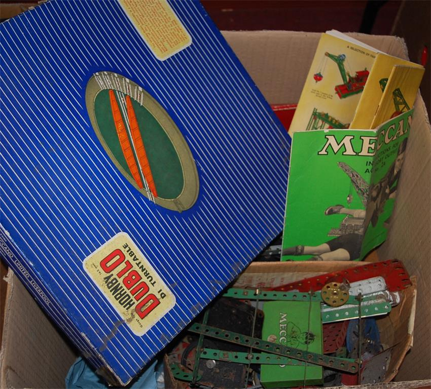 A box of assorted loose Meccano, Hornby Dublo DI turntable, table-top roulette game etc