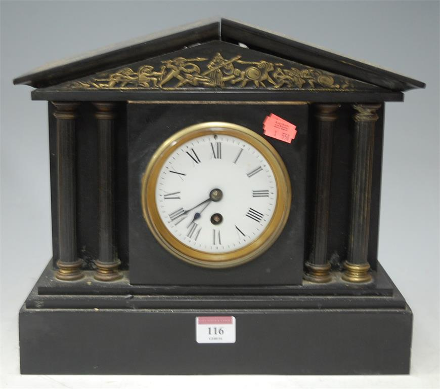 An early 20th century black slate mantel clock of architectural form