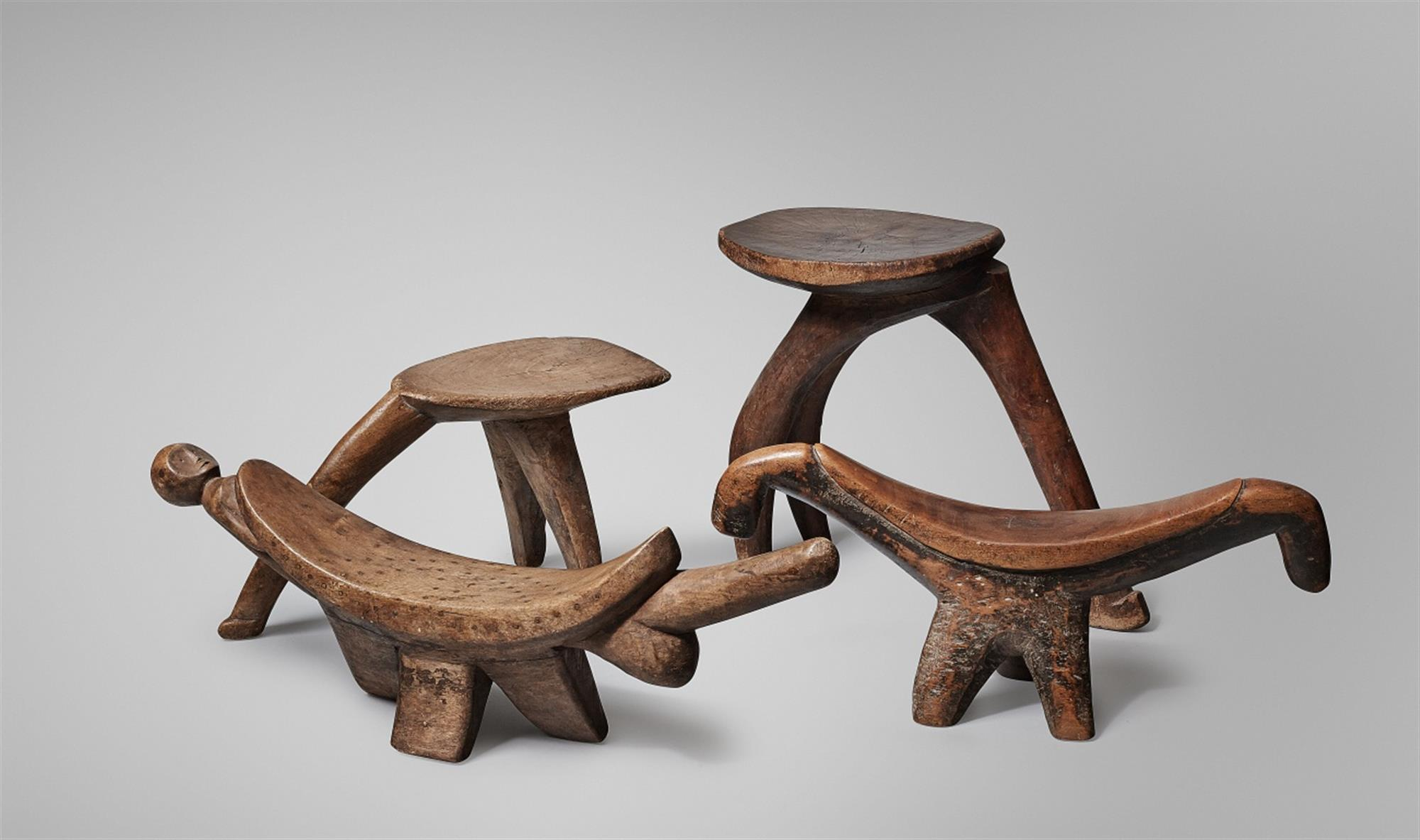 TWO LOBI STOOLS AND TWO SUDAN HEADRESTS
