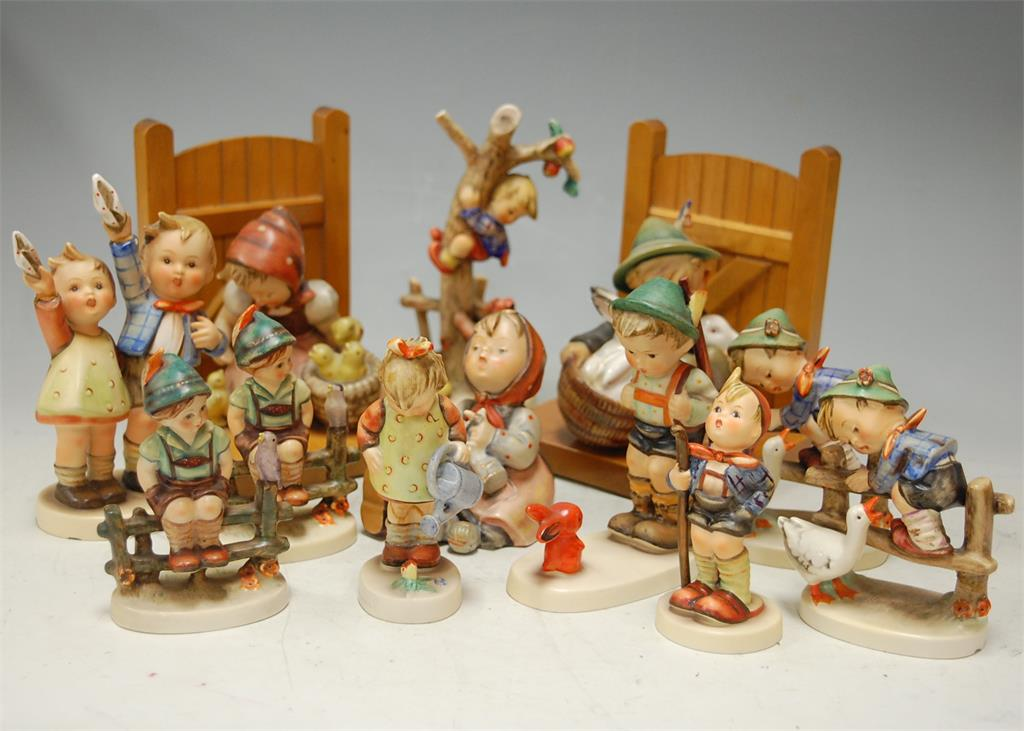 A collection of Hummel figures to include