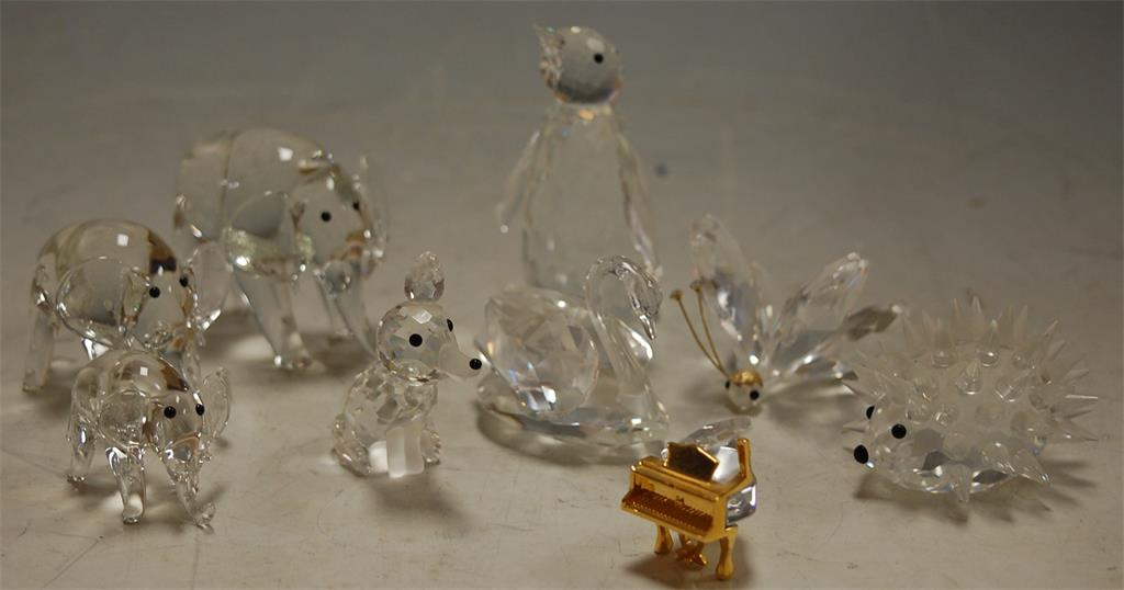 A small collection of Swarovski crystal animal ornaments to include; hedgehog, penguin etc