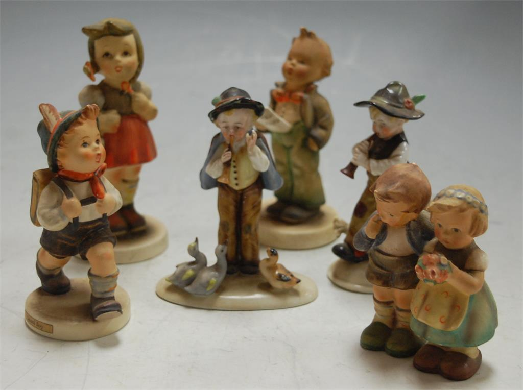 Four Hummel figures to include Schoolboy; together with two other continental figures