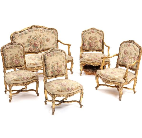 A 19th century Rococo style gilded wood and gesso suite