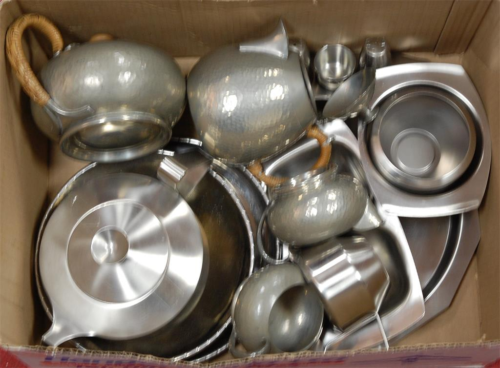 A box of miscellaneous metalwares to include an early 20th century hammered pewter four piece tea and coffee service