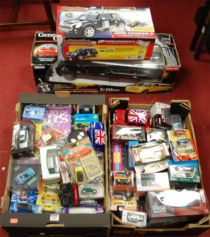 A large collection of assorted boxed modern issue toy vehicles together