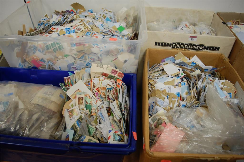 Four boxes of miscellaneous kiloware stamps