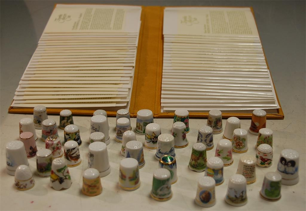 A collection of assorted Thimble Collectors' Club thimbles