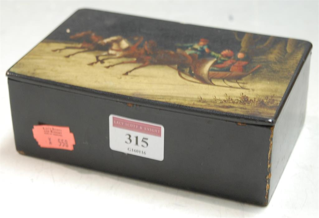 An early 20th century Fedoskino style lacquered cigarette box of rectangular form