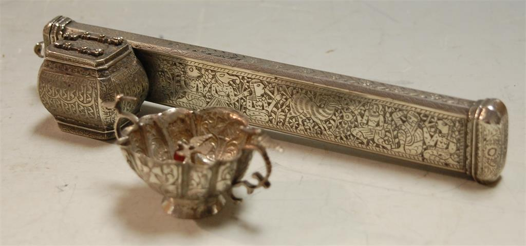 An early 20th century white metal travelling scribes Qalandan with all over inscribed figural decoration