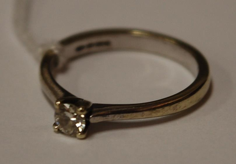 A contemporary 9ct white gold diamond solitaire ring