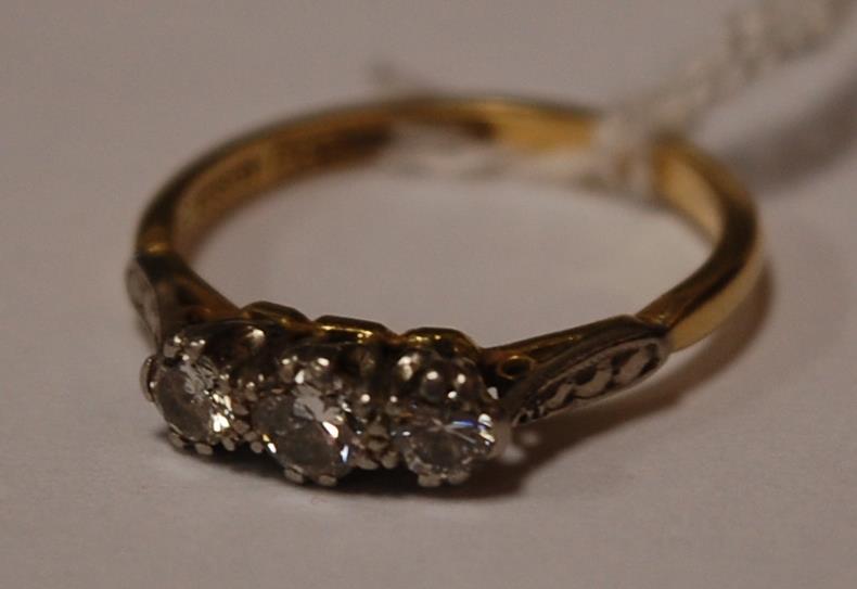 An 18ct yellow gold and platinum diamond three stone ring