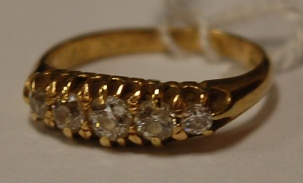 A ladies 18ct gold and rose-cut diamond set five stone ring