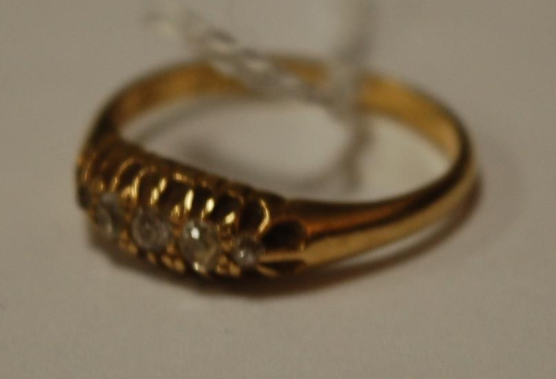 A ladies 18ct gold and five rose-cut diamond set dress ring