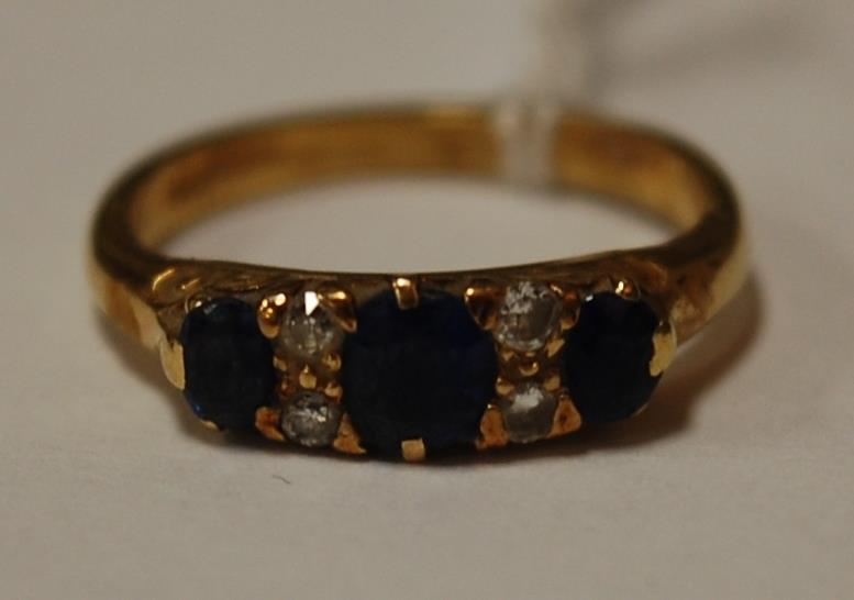 A ladies 18ct gold sapphire and diamond set dress ring
