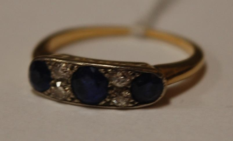 A yellow gold and platinum sapphire and diamond set dress ring