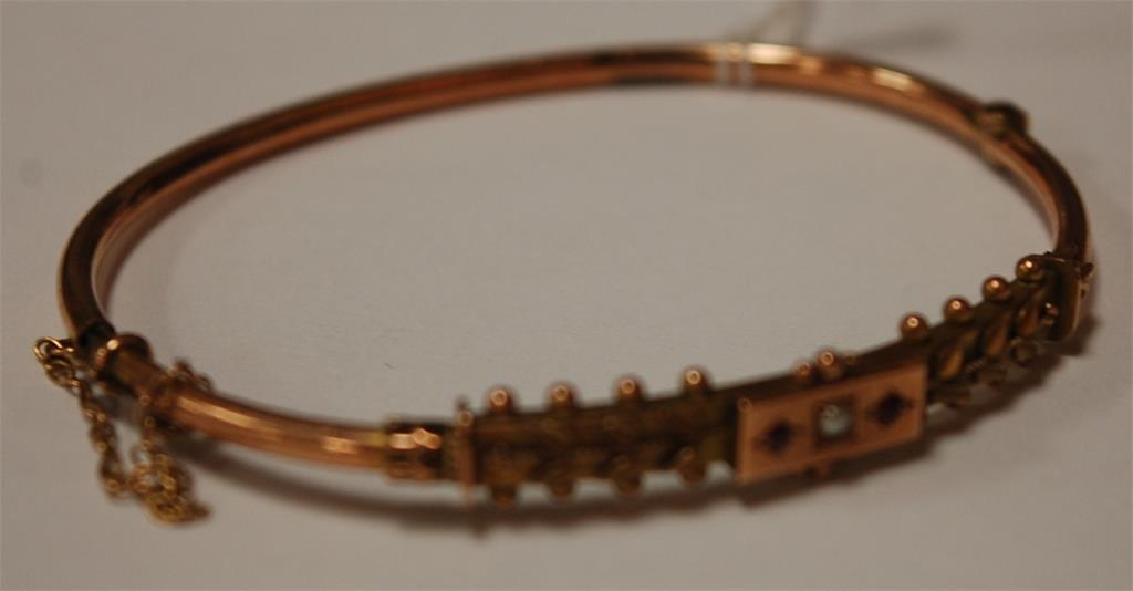 A childs 9ct seed pearl and ruby set bangle, 5.2g