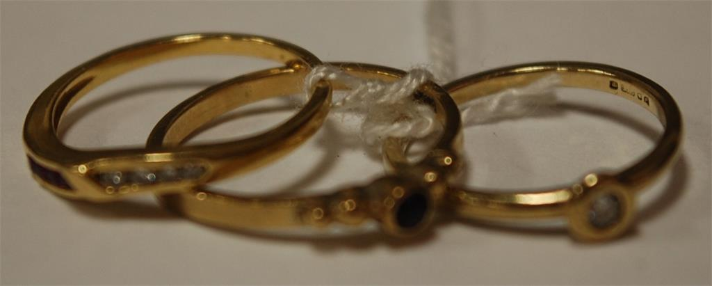 A ladies 9ct gold diamond solitaire ring; one other yellow gold garnet