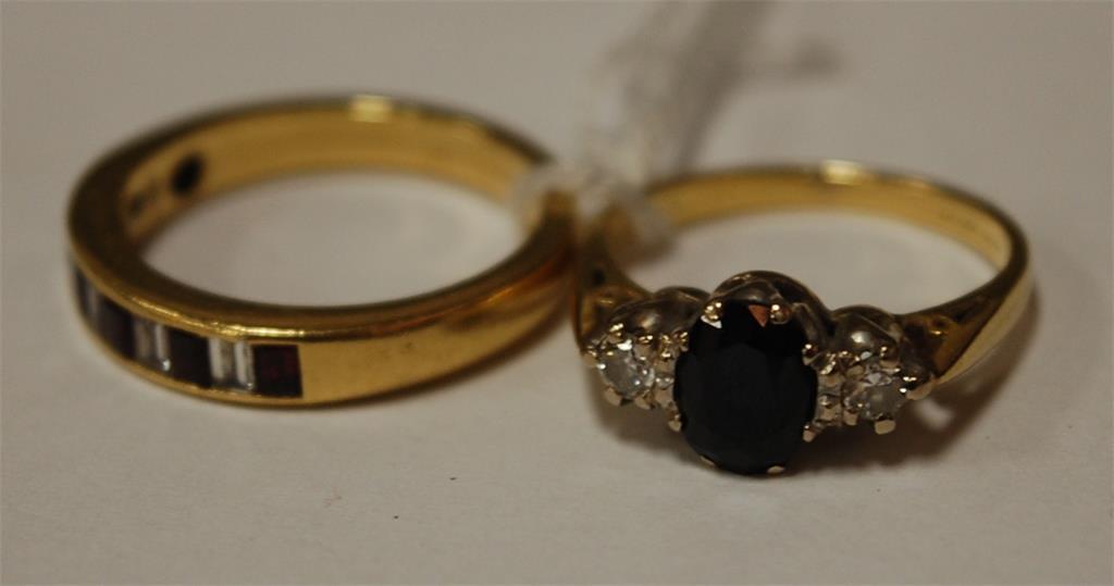 A ladies yellow gold sapphire and diamond set dress ring