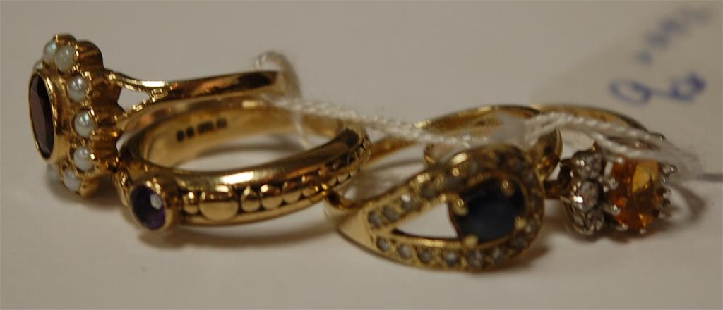 Four various ladies 9ct gold precious and semi-precious set rings to include