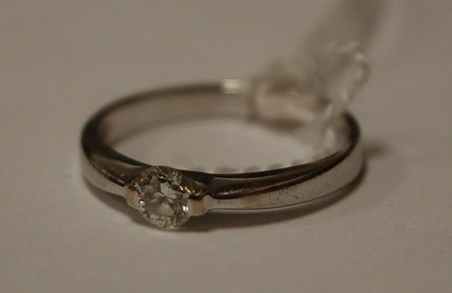 A contemporary white metal ladies diamond solitaire ring