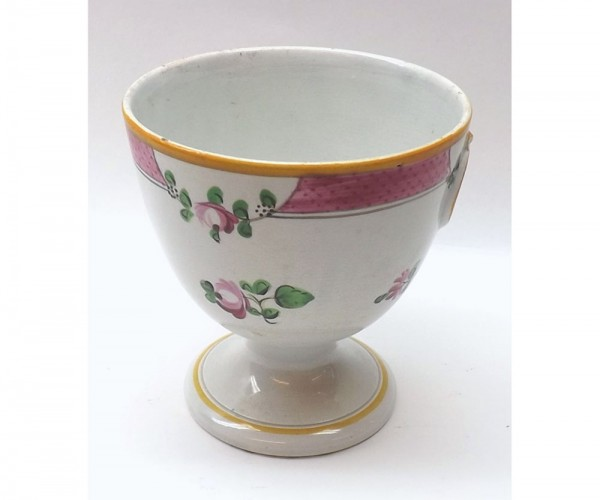 Creamware goblet, moulded on either side with yellow painted ring handles, within puce scale and floral sprig borders and furthe