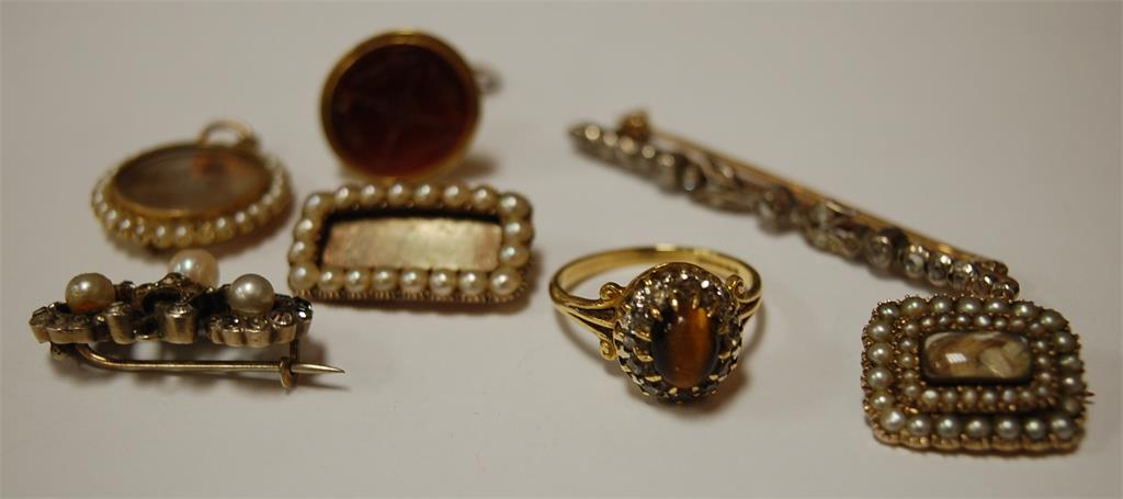 A 9ct gold tigers eye and diamond set cluster ring; a rough cut diamond set bar brooch