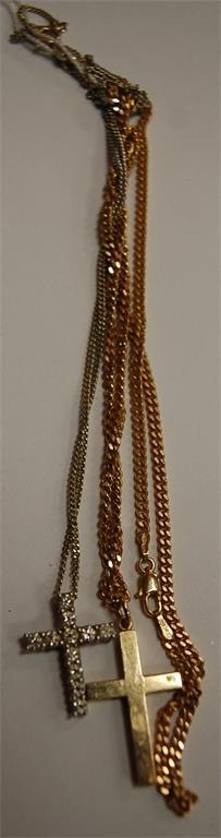 A white metal and diamond set cross pendant