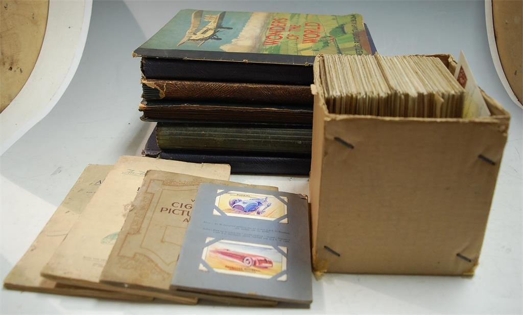 Five various albums of cigarette cards to include Wills