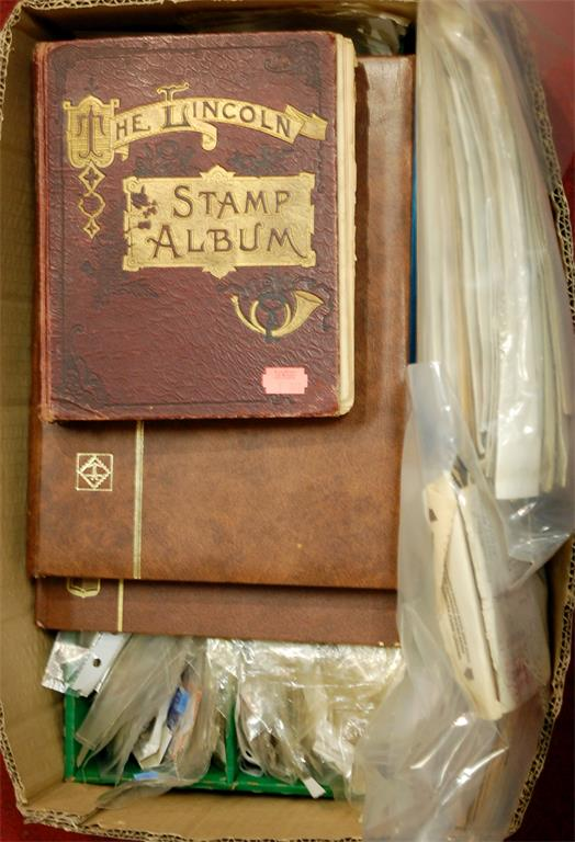A large collection of assorted loose world stamps and first days covers etc