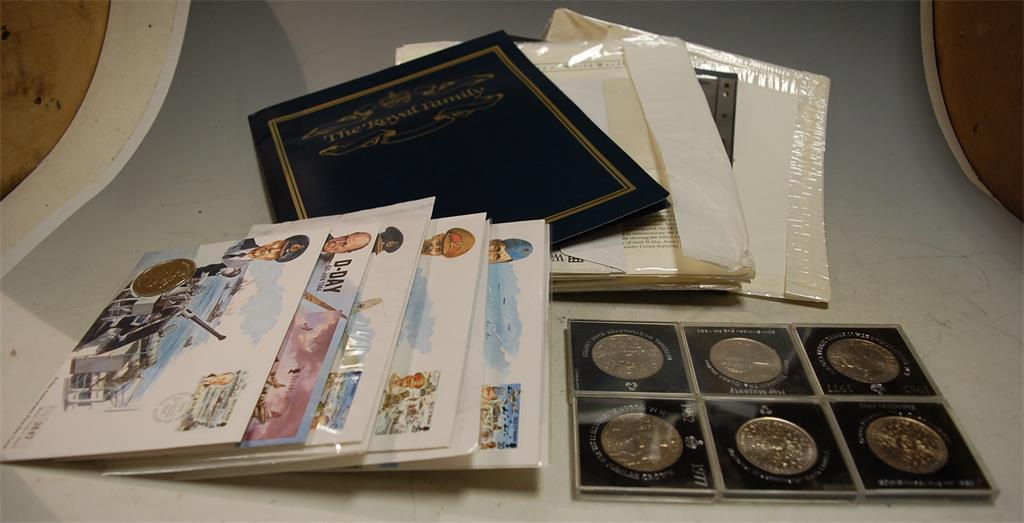 A box of miscellaneous commemorative coinage and first day covers