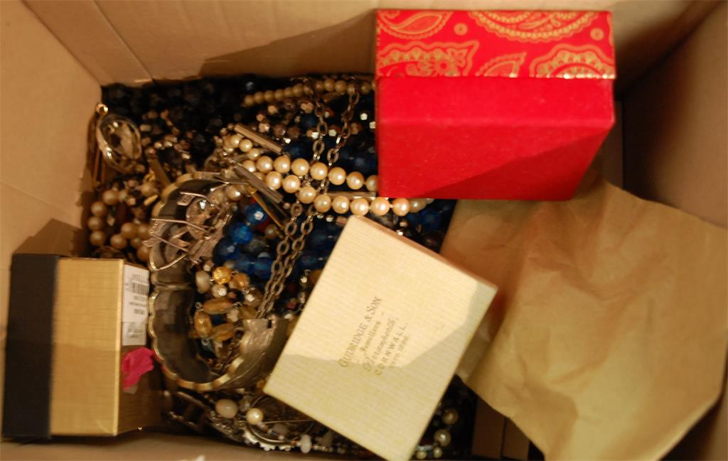 A box of assorted costume jewellery to include faux pearl necklace