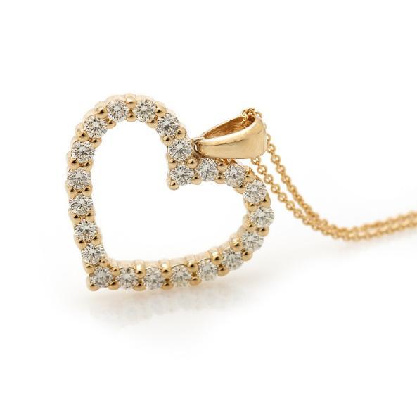 A diamond pendant in the shape of a heart set with numerous brilliant-cut diamonds
