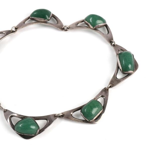 An aventurine necklace set with cabochon-cut aventurines mounted in sterling silver