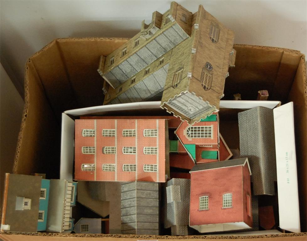 A box of assorted kit built model buildings