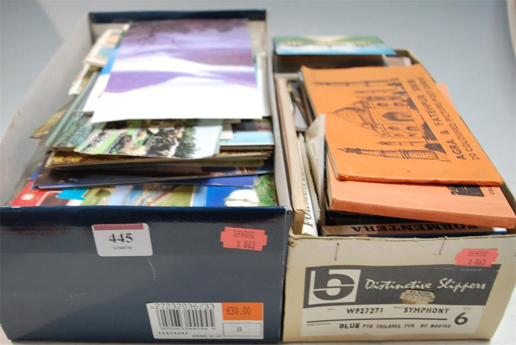 Two boxes of assorted modern postcards to include topographical examples