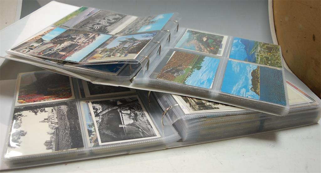 Three albums of various postcards to include mainly modern examples