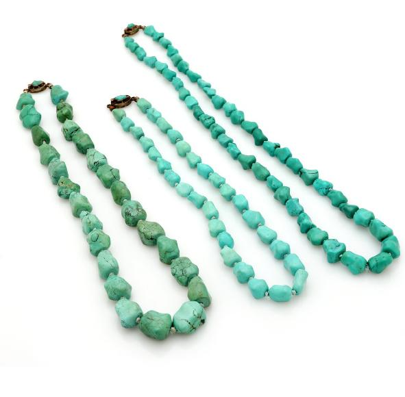 Three turquoise necklaces each set with numerous polished turquoises