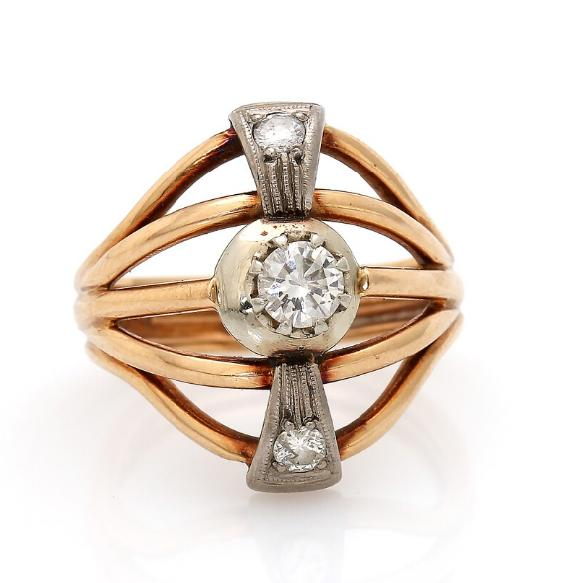 A diamond ring set with three brilliant-cut diamonds, mounted in 14k gold and platinum. Size 56
