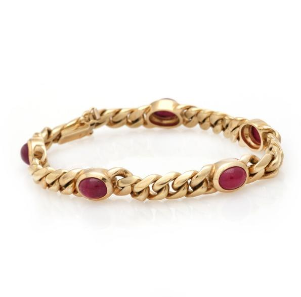 A ruby bracelet set with five cabochon rubies, totalling app. 10 ct., mounted in 14k gold