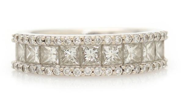 A diamond ring set with nine princess-cut diamonds