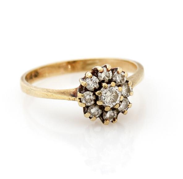 A diamond ring set with numerous brilliant-cut diamonds, mounted in 14k gold. Size 52