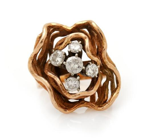 A diamond ring set with five brilliant-cut diamonds, mounted in 14k gold. Size 51.