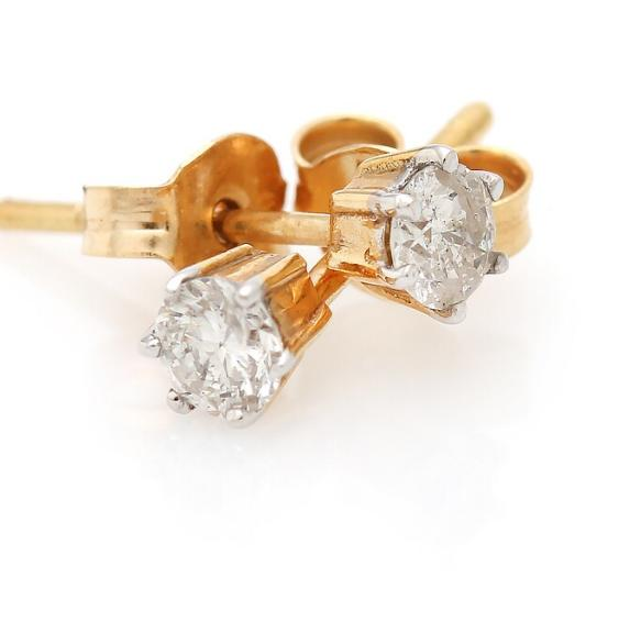 A pair of diamond ear studs each set with a brilliant-cut diamond, totalling app. 0.30 ct., mounted in 14k gold. (2)