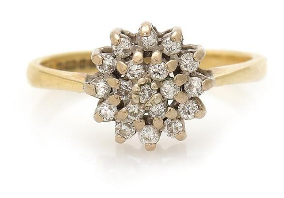 A diamond ring set with numerous brilliant-cut diamonds, mounted in 18k gold. Size 53