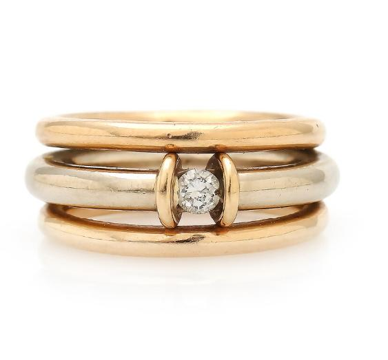A diamond ring set with a brilliant-cut diamond, mounted in 14k gold and white gold. Size 51.