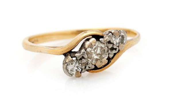 A diamond ring set with three brilliant-cut diamonds, mounted in 14k gold and platinum. Size 53