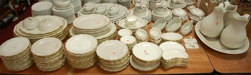 A large extensive Victorian dinner service on a white ground within a gilt border
