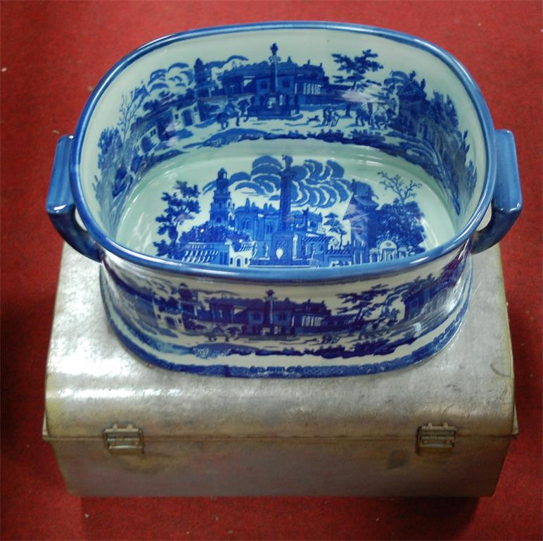 A large modern blue & white twin handled foot bath together with a small tin trunk