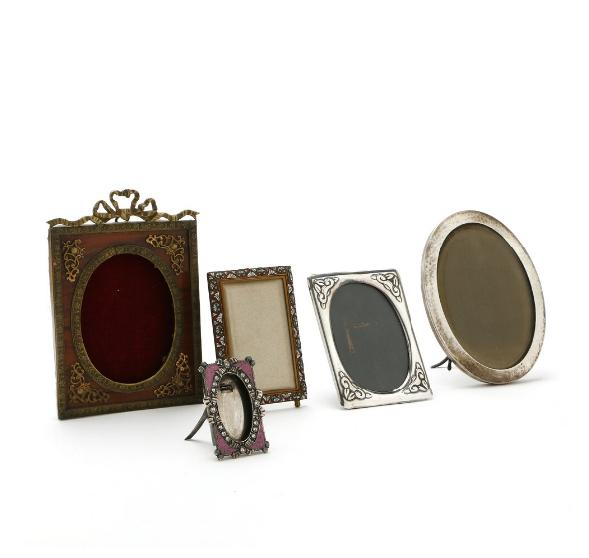 Five first half 20th century photo frames of which three of silver